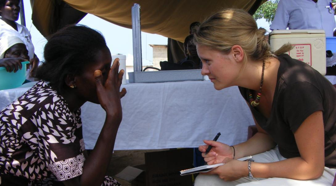 A Projects Abroad volunteer listens to a patient in Ghana during her dentistry internship.